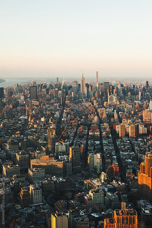 Views of Manhattan skyline at sunset.  by BONNINSTUDIO for Stocksy United