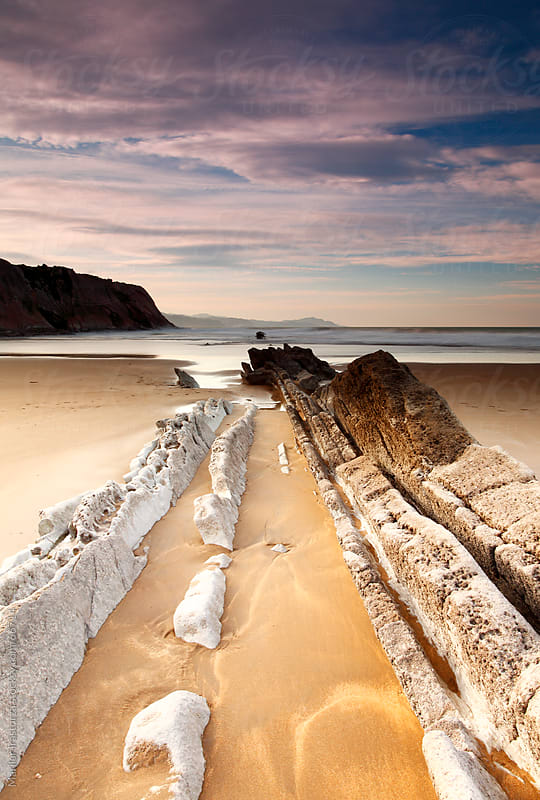 Sunset on the beach of Zumaia, in the Basque Country, in northern Spain by Marilar Irastorza for Stocksy United