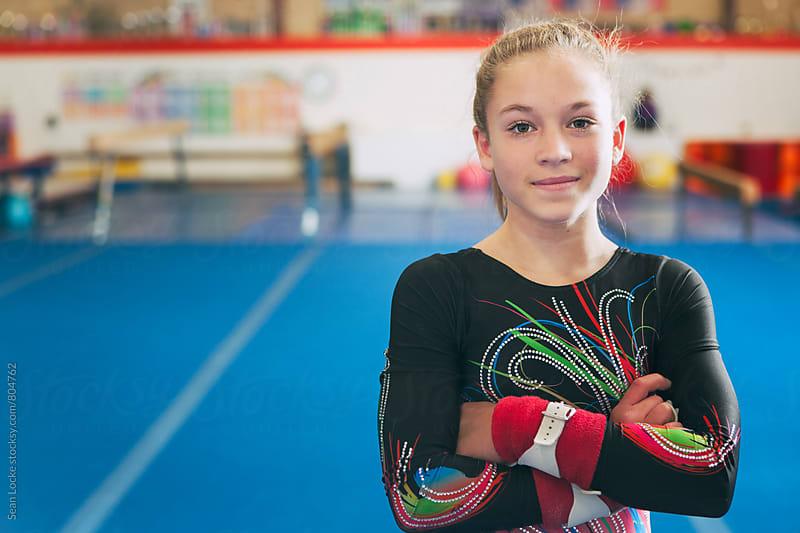 Gymnastics: Smiling Gymnast Looks At Camera by Sean Locke for Stocksy United