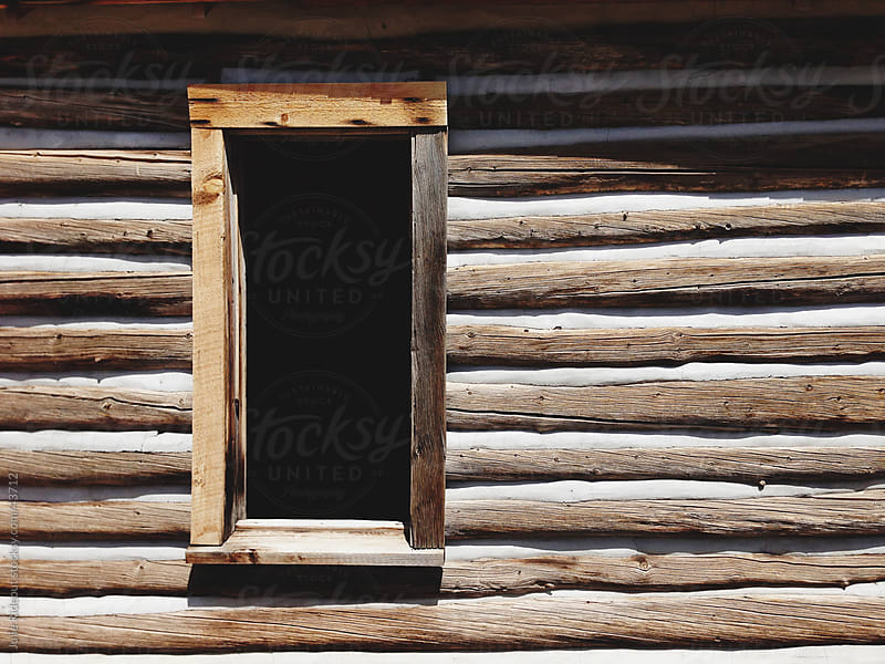 Log Cabin Window by Julie Rideout for Stocksy United