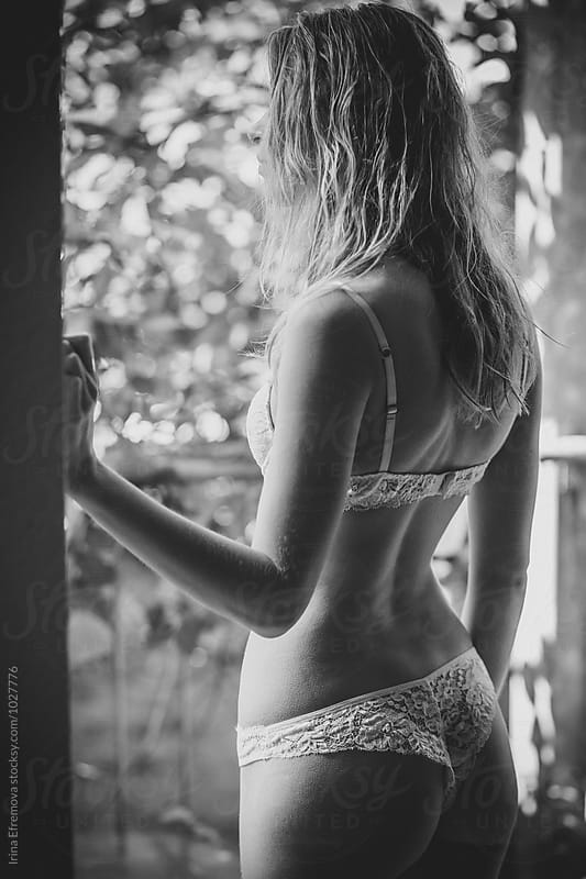 Back of the girl in white lace underwear by Irina Efremova for Stocksy United