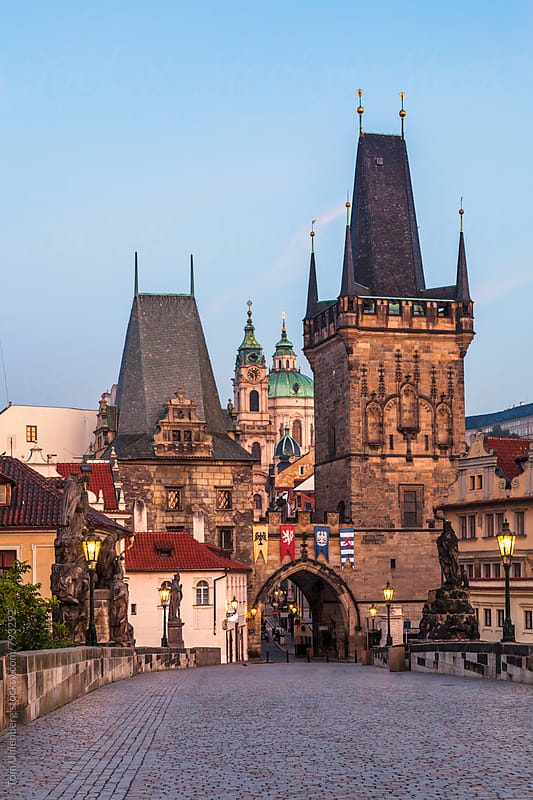 Prague, the Czech Republic - The Lesser Town Bridge Tower (Malostranská mostecká věž) and the Charles Bridge (Karlův most) at Sunrise by Tom Uhlenberg for Stocksy United
