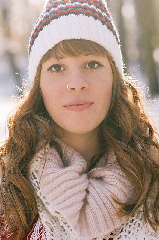 Portrait of a beautiful young girl with winter hat by Aleksandra Jankovic for Stocksy United