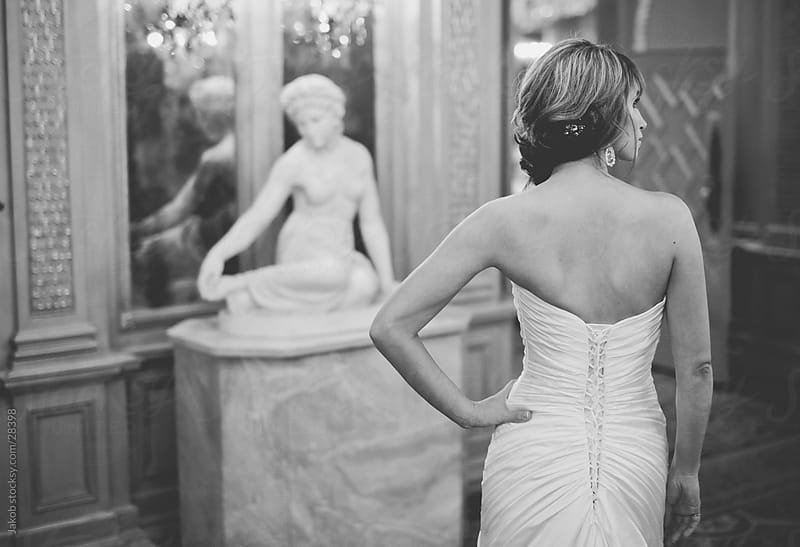 Beautiful bride in a wedding dress with her back turned by Jakob for Stocksy United