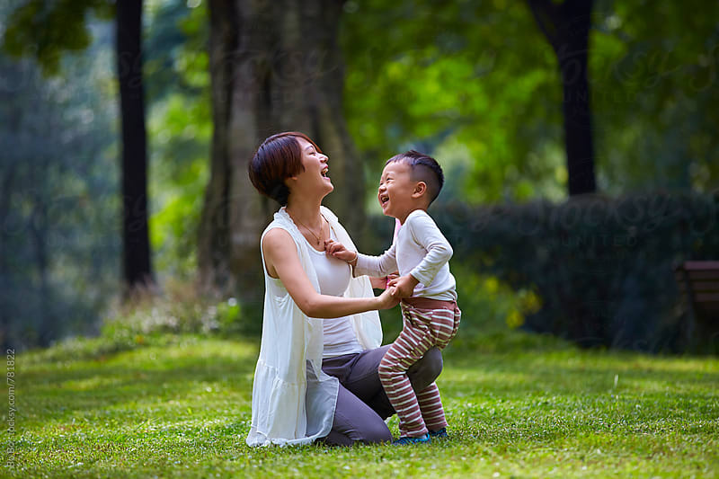 little asian boy playing with his mother outdoor in the park by Bo Bo for Stocksy United