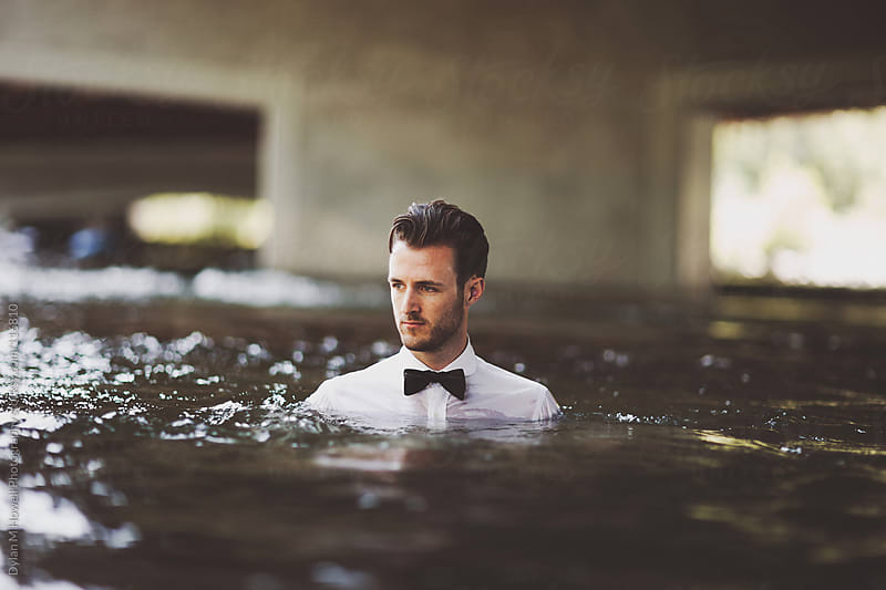 tuxedo shirt and bow tie in river by Dylan M Howell Photography for Stocksy United