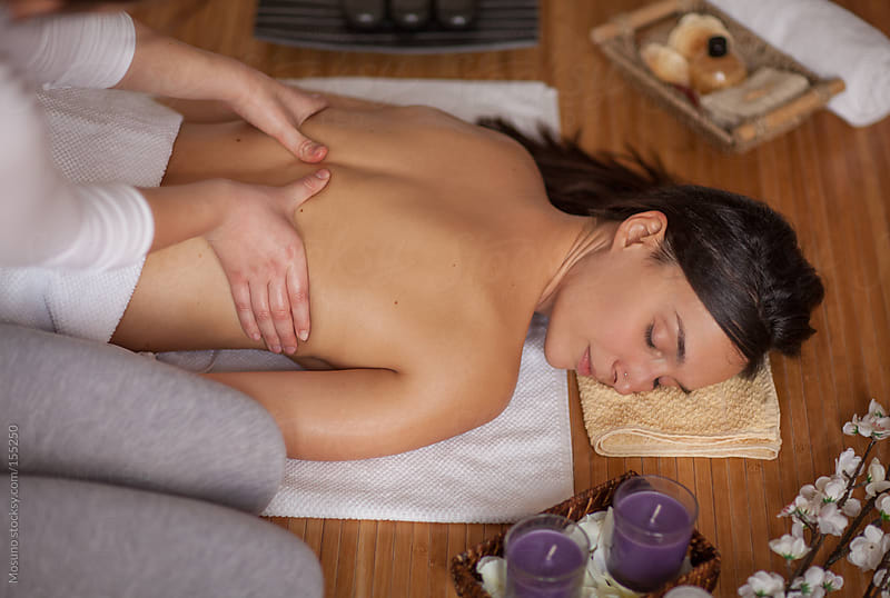 Woman Receiving Back Massage in Spa Center by Mosuno for Stocksy United
