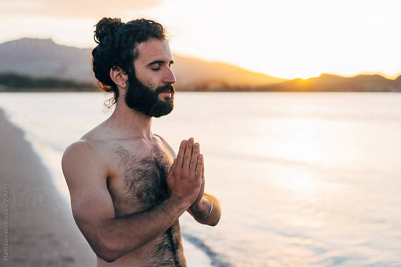 Bearded man with eyes closed in Namaste by Martí Sans for Stocksy United
