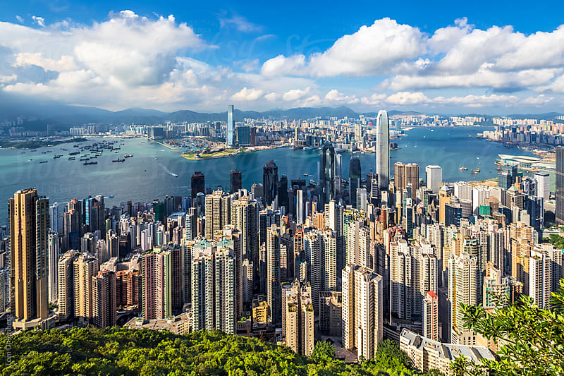 Panorama of Hong Kong, as seen from Victoria Peak on a sunny day by Tom Uhlenberg for Stocksy United