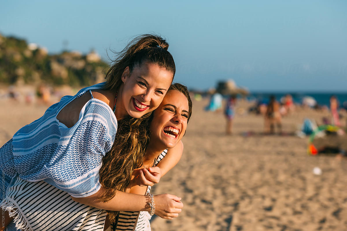 Two friends laughing on the beach by VICTOR TORRES - Beach, Friend ...
