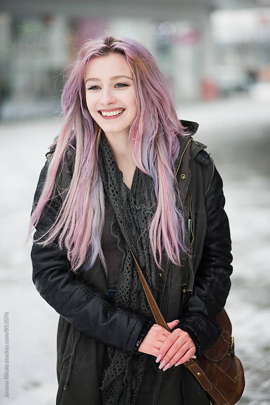 Happy young woman with pastel hair smiling by Jovana Rikalo for Stocksy United