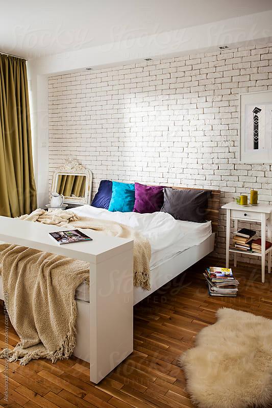 Cozy bedroom by Aleksandar Novoselski for Stocksy United