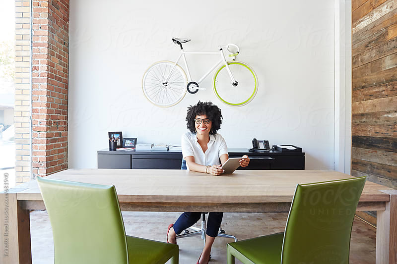Portrait of millennial businesswoman in office by Trinette Reed for Stocksy United