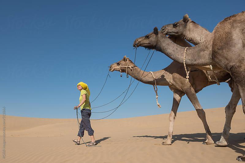 camel herder in the desert by RG&B Images for Stocksy United