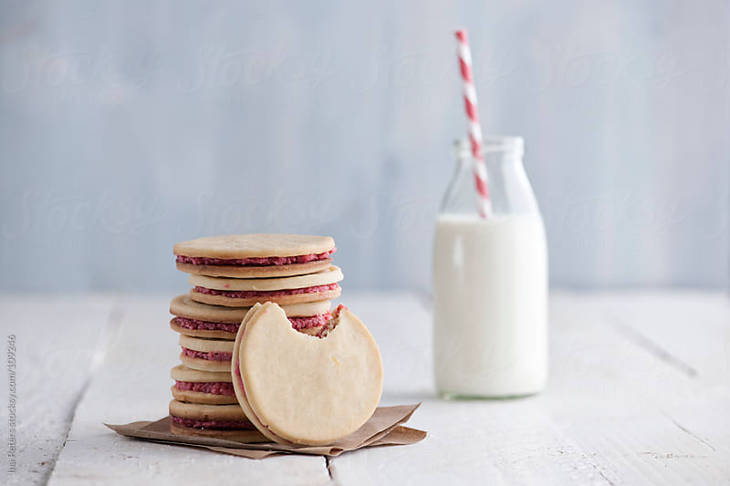 Food: Homemade Cookies filled with Raspberry Buttercream by Ina Peters for Stocksy United