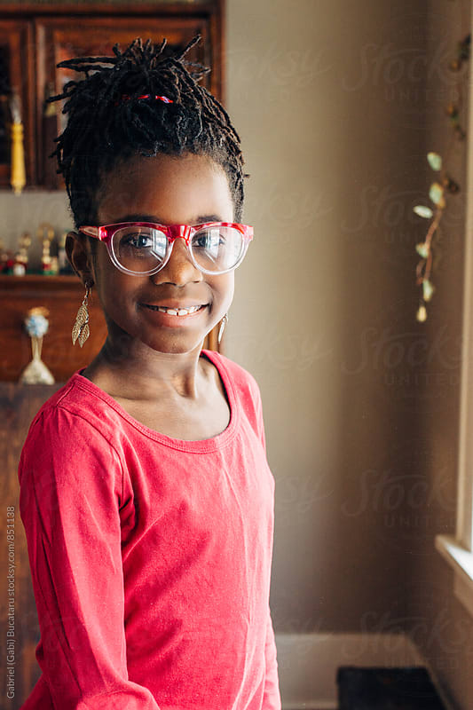 African American girl with glasses and pink shirt by Gabriel (Gabi) Bucataru for Stocksy United