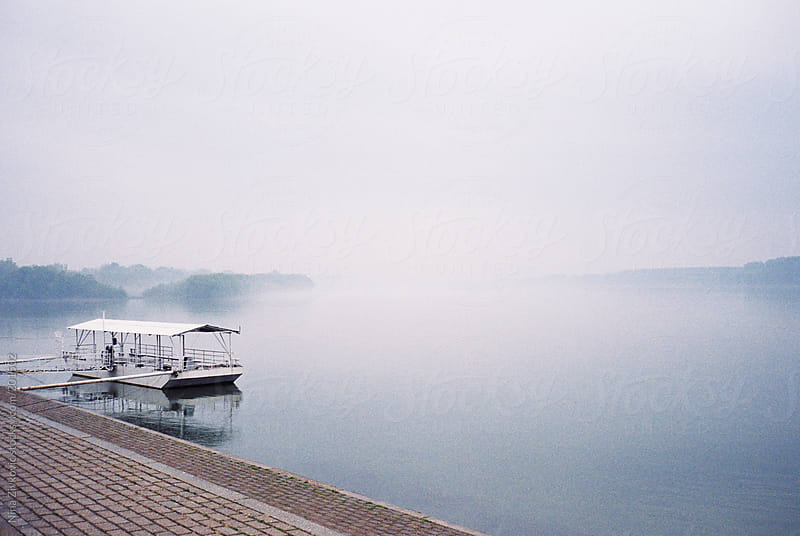 A foggy day on the river. by Nina Zivkovic for Stocksy United