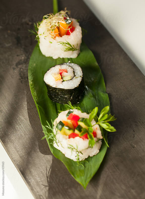 Sushi served on the leaf plate. by Mosuno for Stocksy United