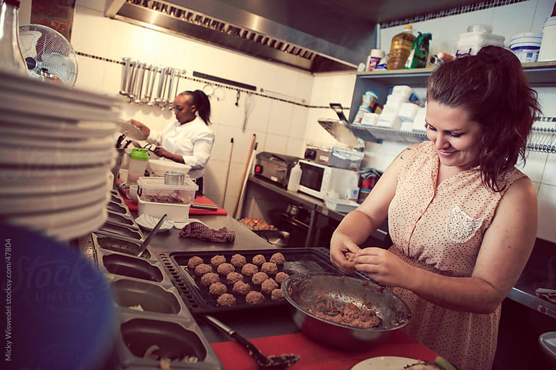 Women cooking in a restaurant kitchen by Micky Wiswedel for Stocksy United