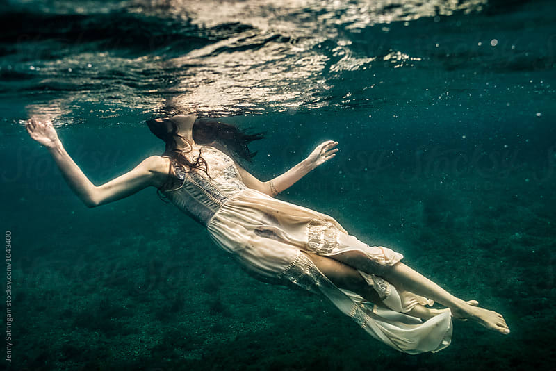Underwater photo of Beautiful woman swimming in boho dress by Jenny Sathngam for Stocksy United