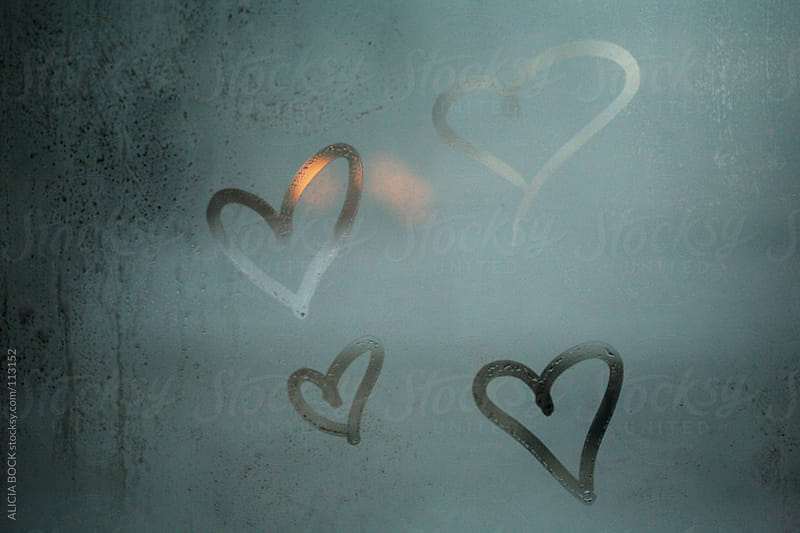 Hearts Drawn By Hand On A Glass Window by ALICIA BOCK for Stocksy United