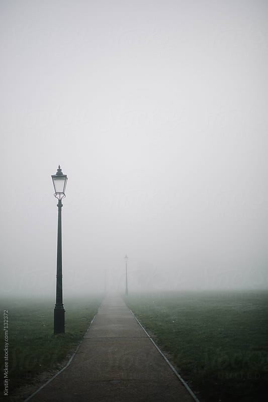 Lamp post in the fog. by Kirstin Mckee for Stocksy United