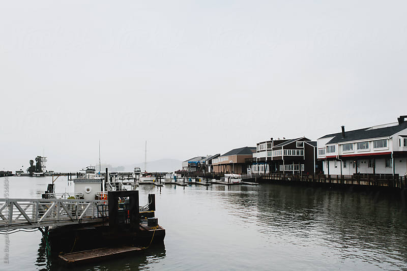 Gloomy day on a pier by Ellie Baygulov for Stocksy United
