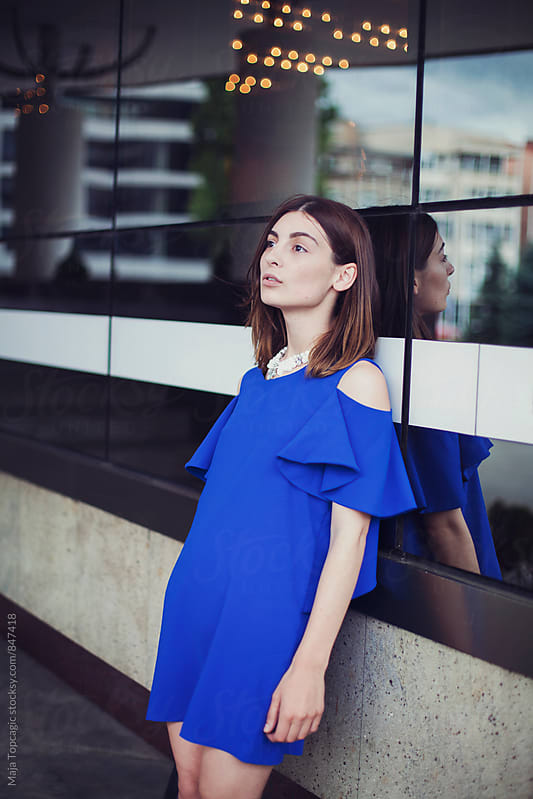 Beautiful fashionable young woman in the city by Maja Topcagic for Stocksy United