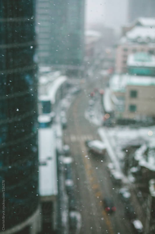 Snowy city view from above. by Cherish Bryck for Stocksy United