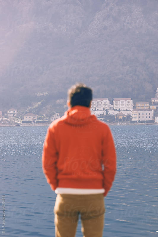 Young guy is watching the sea by B & J for Stocksy United