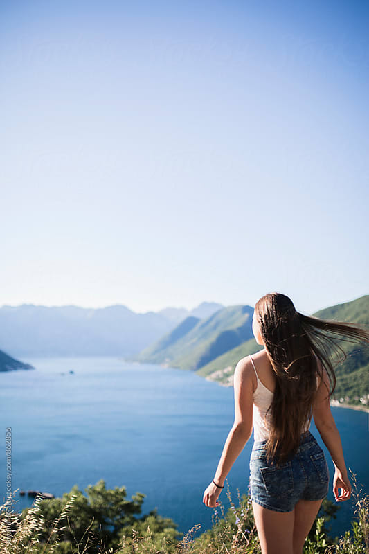 Portrait of a beautiful young woman standing on the rock by Jovana Rikalo for Stocksy United