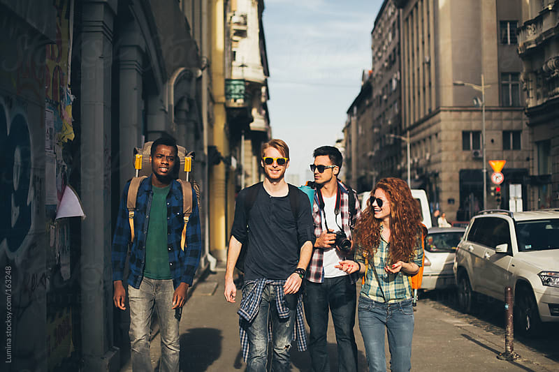 Backpackers in the City by Lumina for Stocksy United