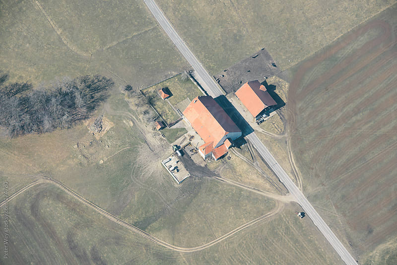 Aerial view of farm by Peter Wey for Stocksy United