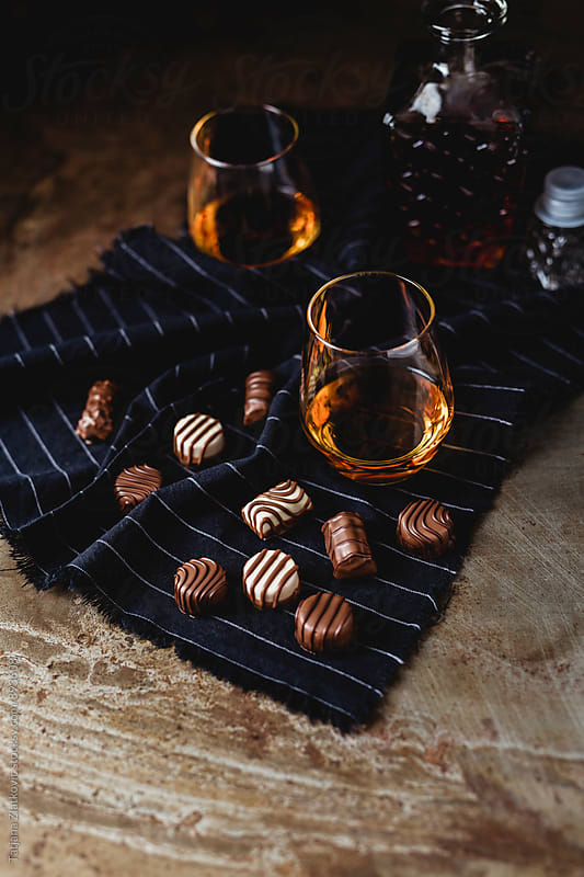 Cognac with pralines by Tatjana Ristanic for Stocksy United