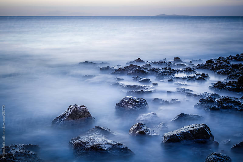 rocks in sea waves by Helen Sotiriadis for Stocksy United