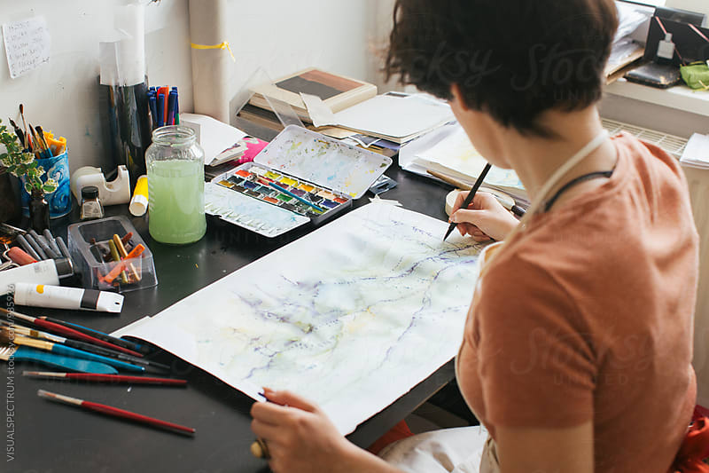 Art Studio - Young Brunette Painter Sitting on Desk and Using Art Pen by VISUALSPECTRUM for Stocksy United