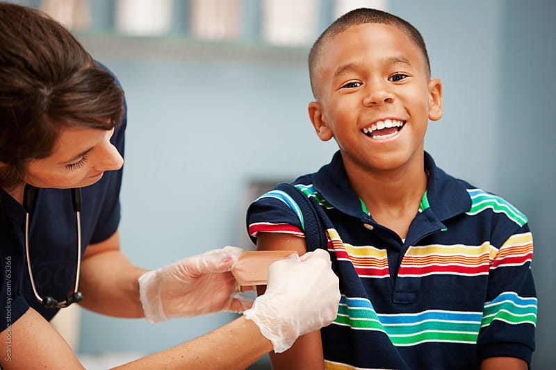 Pediatrician: Boy Happy to Be Done with Shot by Sean Locke for Stocksy United