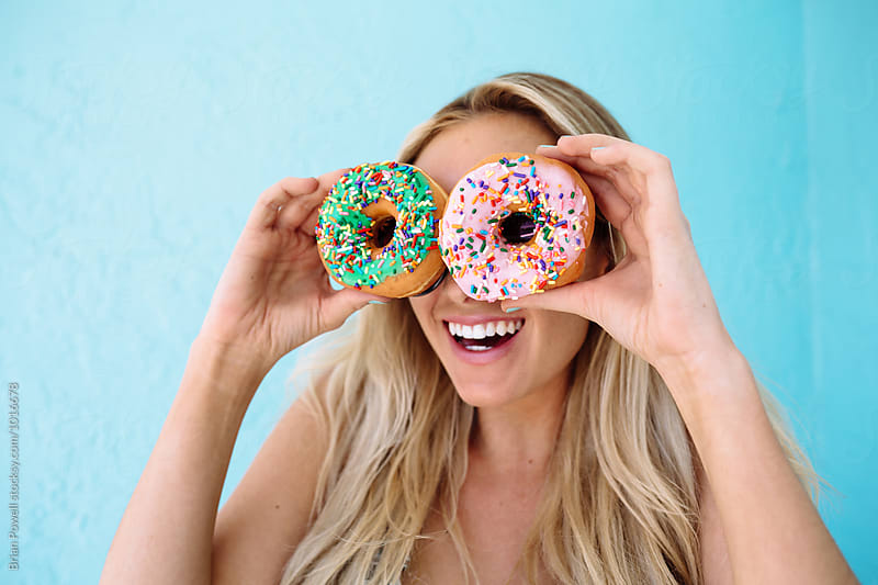 woman with donut eyes by Brian Powell for Stocksy United