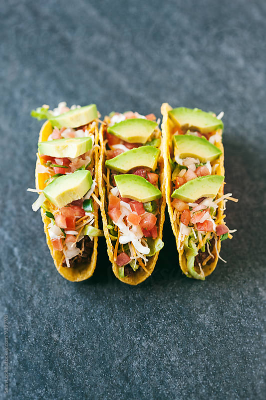 Tacos: Three Tacos Side By Side With Copyspace by Sean Locke for Stocksy United