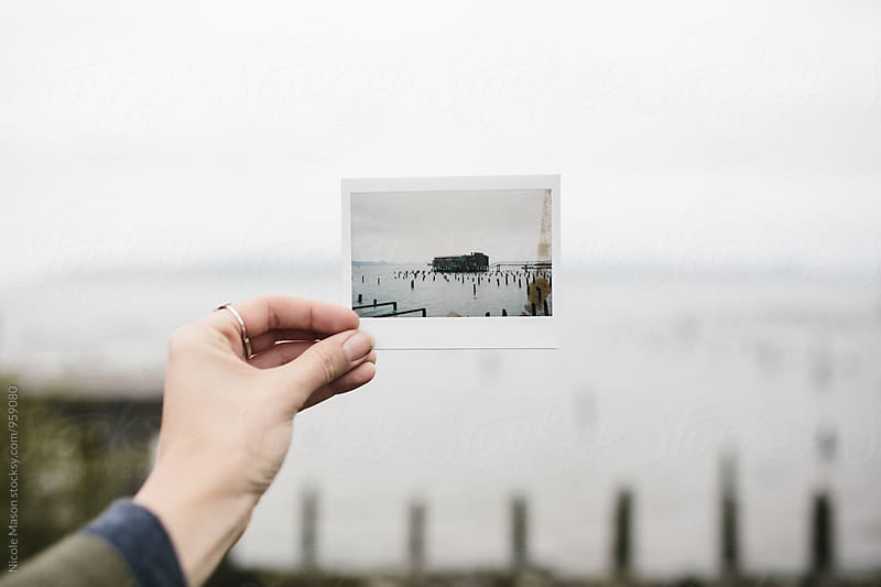 instant photo of boat house on the water by Nicole Mason for Stocksy United