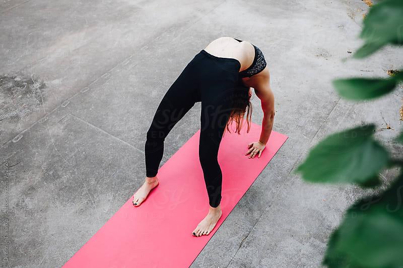 Woman doing yoga  by Dimitrije Tanaskovic for Stocksy United