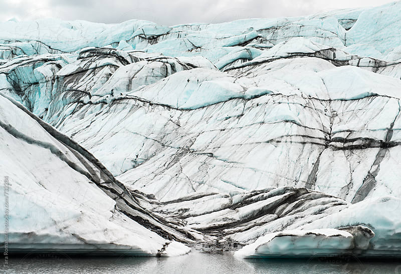 glacier lines at water's edge by Tara Romasanta for Stocksy United