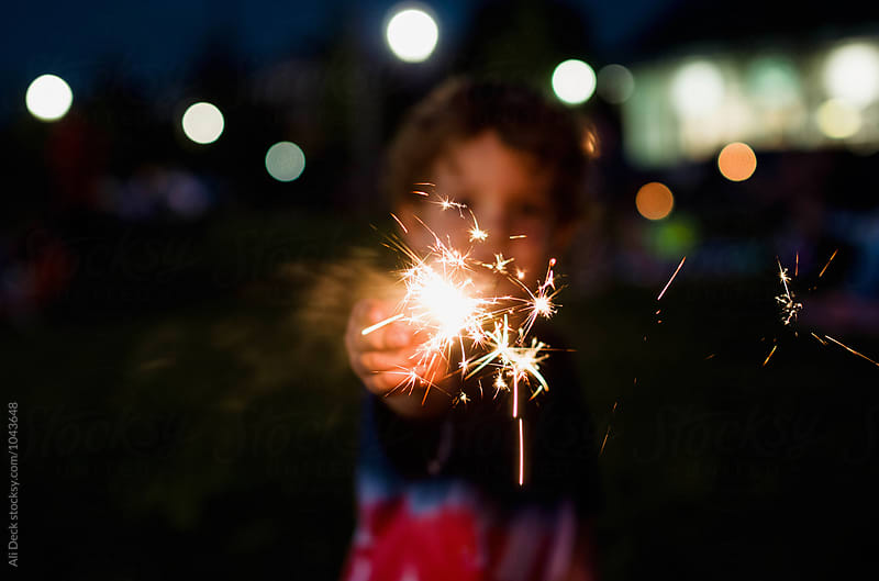 Sparkler on the Fourth of July by Ali Deck for Stocksy United