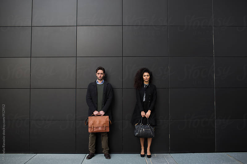 Portrait of business people on the black wall by michela ravasio for Stocksy United