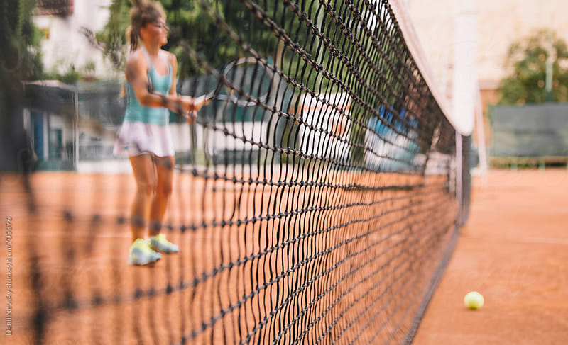 Closeup of the tennis net by T-REX & Flower for Stocksy United