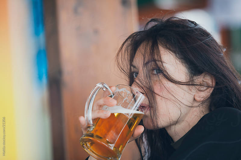 Woman Drinking Beer Alone by HEX. for Stocksy United