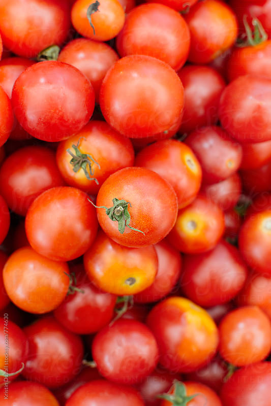 Fresh whole cherry tomatoes by Kristin Duvall for Stocksy United