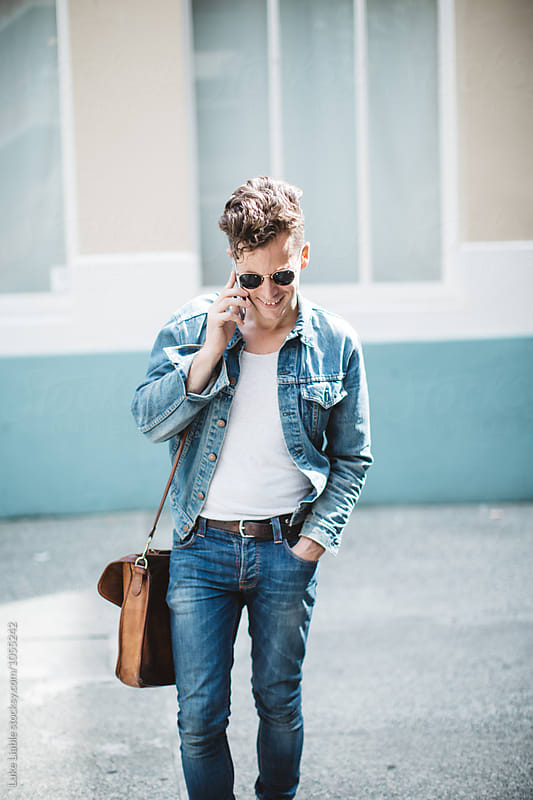 Stylish business man talking on phone  by Luke Liable for Stocksy United