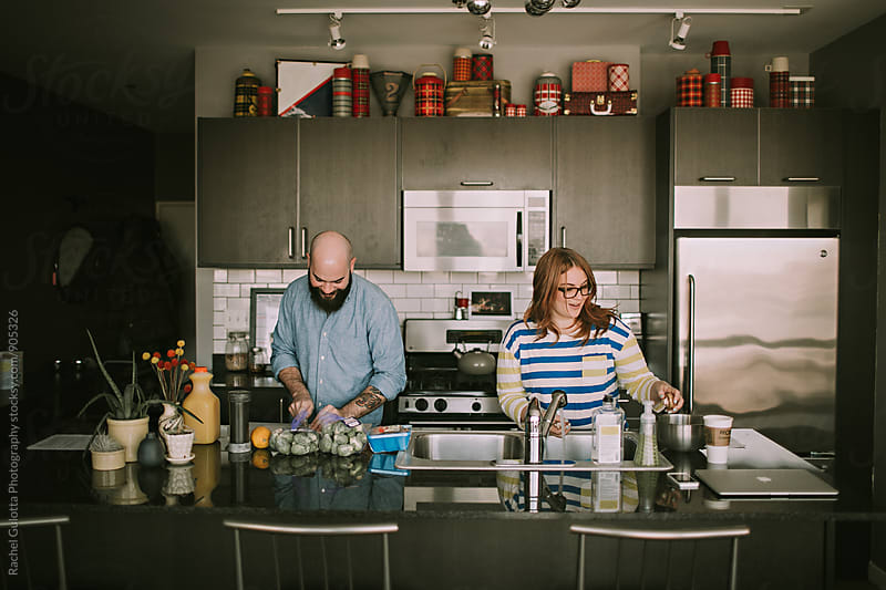 A Young Couple Chops Vegetables - Lifestyle Food and Cooking by Rachel Gulotta Photography for Stocksy United