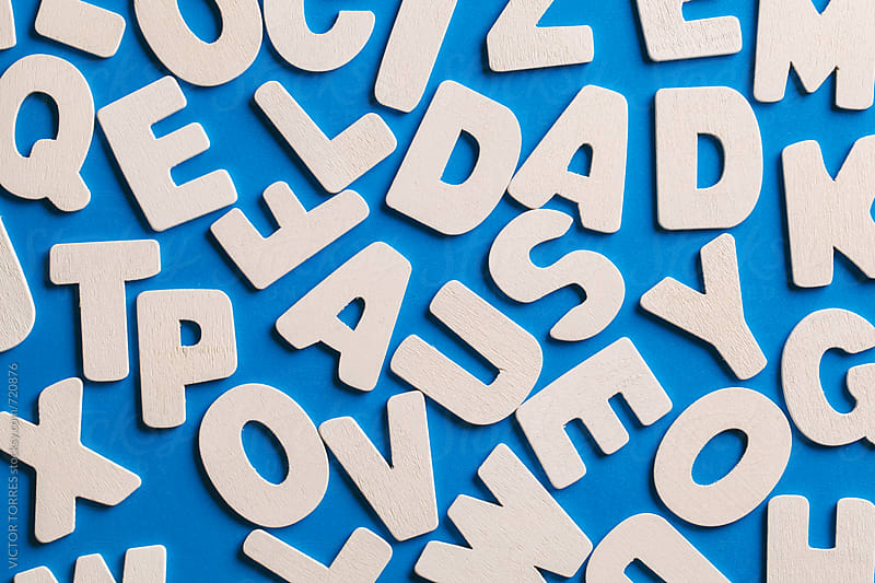 Background of White Wooden Letters on a Blue Cardboard by VICTOR TORRES for Stocksy United